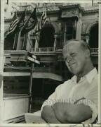 1966 Press Photo Raymond A. Sanchez Front Of Sheraton-charles Hotel With Flag