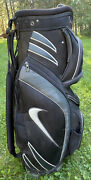 Nike Golf Cart Bag. 14 Deviders. 7 Pockets. Rain Top. And Carry Strap.