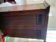 Large Shelved Wooden Ar-moire With Glass Windows. Decent Condition. Pickup Only