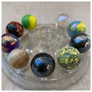 Collection Of Glass Marbles And On An Vintage Glass Flower Frog