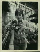1976 Press Photo Mary Ellen Duffy Examines Ivy Plant At College, Troy, New York