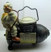 Michelin Man Sitting On A Compressor Coin Bank