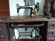Antique Singer Sewing Machine In Cabinet. With Original Assceories.