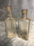 Lot Of 2 Embossed Antique Sloan's Liniment And Dr Bell's Pine Tar And Honey Bottles