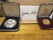 End Of World War Ii 75th Anniversary 24-karat Gold Coin And Silver Medal On Hand