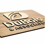 Natural Wood Background With Wood Lettering Lobby Sign