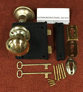 Modern Rim Lock With Brass Plated Knobs, Keyholes, And Keys
