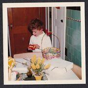 Vintage Photograph Little Boy Holding Toy From Easter Basket In Retro Kitchen