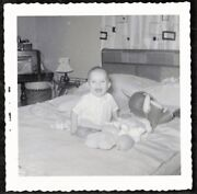 Antique Vintage Photograph Cute Little Baby On Bed W/ Toys Laughing