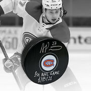 Alexander Romanov Autographed Montreal Canadiens Puck With 1st Game Inscription