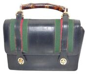 Black Leather Lunchbox Purse W Bamboo Handle And Red/green Striped Accents