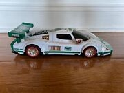 Red White And Green Hess Truck, 2009 Race Car, 1ft And 5 Inches Long.