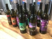 Case Of Used Green Wine Bottles With Labels
