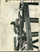 1965 Press Photo Boomer Willy Burrough A Bolter-up Secures The Ladder Upwards