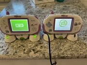 2 Leapster Explorer Systems 7 Games Cases And Recharging Batteries