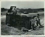 1975 Press Photo Rescue Personnel Remove People From Overturned Van - Mja53298