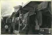 1983 Press Photo John Madison Looks Out Back Door And Ducks Under Washing Line.