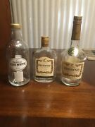 Three Empty Hennessy Cognac Bottles One Hennessy Pure White