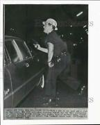 1964 Press Photo New York Cop With Gun, Club Takes Cover In Harlem Riot