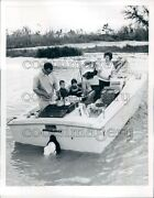 Family Cooking And Eating On Vintage Motor Boat Press Photo
