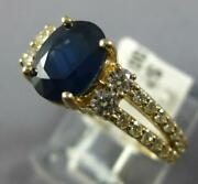Wide 2.05ct Diamond And Aaa Sapphire 14kt Yellow Gold Oval And Round Engagement Ring