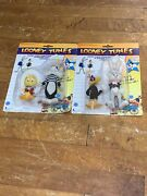 Loony Tunes Characters Tweety, Sylvester, Daffy Duck, And Bugs Bunny