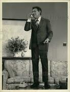 1973 Press Photo Actor Jack Gilford Talking On Phone While Standing On Table