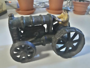 Cast Iron Model Of A Ford Tractor With A Tractor Driver. Old Toy