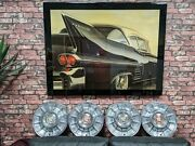 1957 Cadillac Hubcaps W/ Medallions