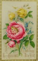 1870's-1880's Victorian Christmas Trade Card Poem On Back Girl In Rose P67