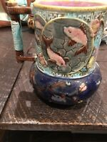 Old Majolica Pitcher With Flowers And Fish