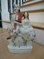 Staffordshire porcelain  Figure  Scottish  Man and woman  Kilts  and clock