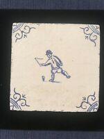 EARLY DUTCH BLUE & WHITE DELFT TILE of a boy spinning a top C.1745