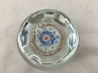Faceted dimpled millefiori glass paperweight w/red center