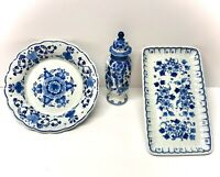 Royal Delft Pottery Pieces - Lidded Vase, Serving Platter, And Shallow Bowl.