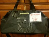 NWT True Religion Lightweight Duffel Bag Carry On Zip Up Big T Jeans Pocket