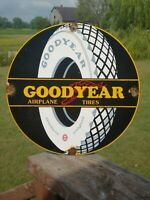 VINTAGE 1930'S GOODYEAR AIRPLANE TIRES PORCELAIN METAL SIGN! ALL WEATHER