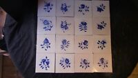 A Set Of 16 Dutch Delft Tiles With FlowersBirds and Insects