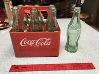 Vintage Plastic Coca Cola Carrier and 6 + 1 Extra Green Bottle