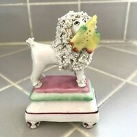 ANTIQUE STAFFORDSHIRE POODLE FIGURE HOLDING A BIRD IN IT'S MOUTH