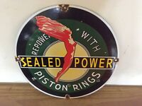 VINTAGE PORCELAIN SEALED POWER PISTONS  GAS AND OIL SIGN