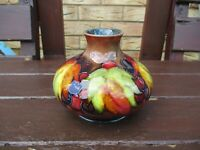Moorcroft Pottery flambe leaves and berry squat vase