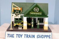MENARDS QUAKER STATE GAS STATION. O SCALE. EXC COND IN BOX.