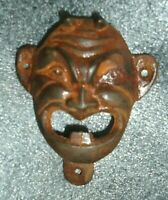 genuine  old cast iron devil face wall mounted bottle opener