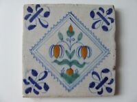 A Dutch Delft Polychrome tile with Flower in Diamond 17th. C.