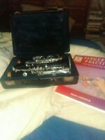 Selmer clarinet with hard case. And fingering practice book.