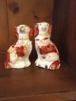Two small antique Staffordshire dog figurines