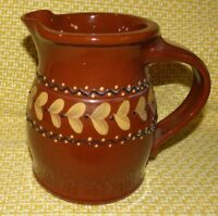 ELDRETH POTTERY 1999 BROWN GLAZED PITCHER~ HEARTS IN A BAND IN CREAM