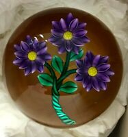 BOB BANFORD  Glass Paperweight: 3 Violet and Yellow Flowers w/ Amber Background