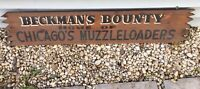 "Vintage Wood Hand Painted Sign ""Beckman's Bounty Chicago Muzzelloaders"" 49"" Wide"